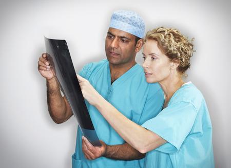 self testing: Doctors Examining X-Ray