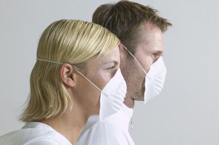 ah1n1: Close-up Portrait of Couple Wearing Face Masks