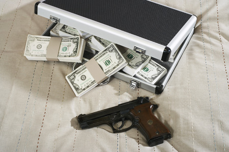 societal: Gun and Briefcase Full of Money