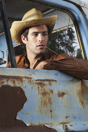 non: Man In Cowboy Hat and Rusty Truck