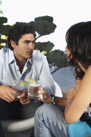 end of a long day: Couple Chatting Over Drinks LANG_EVOIMAGES