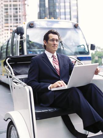 Businessman With Laptop Computer, Sitting in Rickshaw