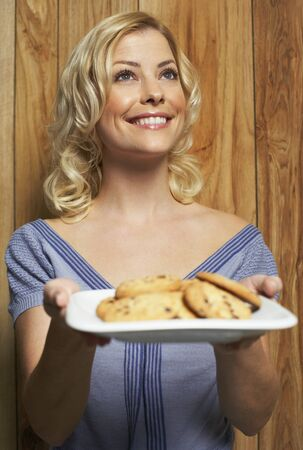 wood panelled: Portrait of Woman With Plate of Cookies