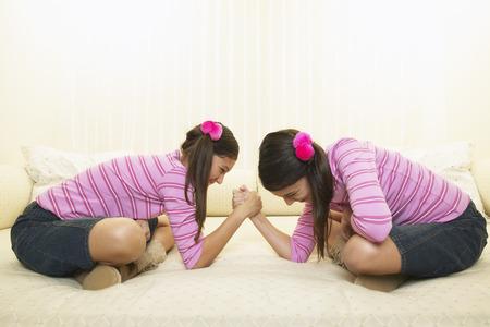 Twin Girls Arm Wrestling