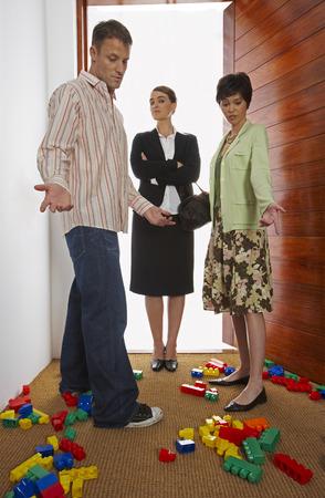 merchant: Couple Greeting Nanny at Door