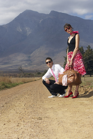 A Young Couple Hitchhiking LANG_EVOIMAGES