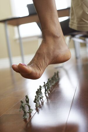 Woman Stepping on Army Men Toys