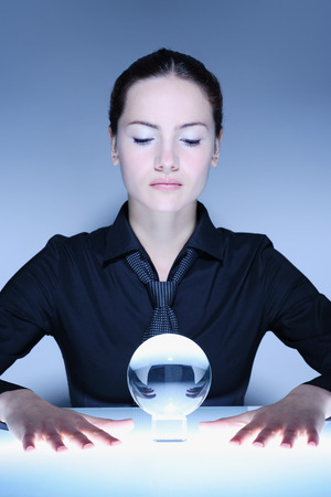 Woman Looking into Crystal Ball