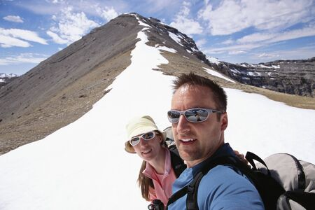 Couple Hiking at Canadian Rockies LANG_EVOIMAGES