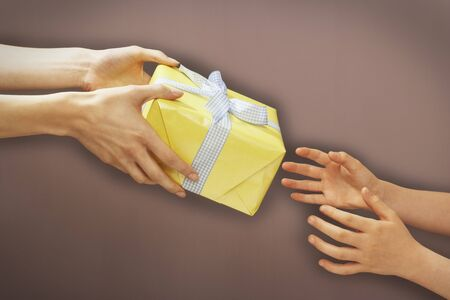 Hands Giving Gift LANG_EVOIMAGES