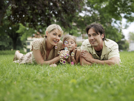 age 25 30 years: Portrait of Family Outdoors