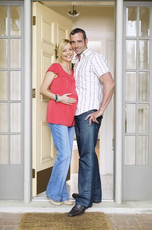 30 years old man: Pregnant Couple in Doorway LANG_EVOIMAGES