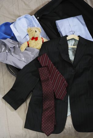 Business Clothes and Teddy Bear in Suitcase LANG_EVOIMAGES