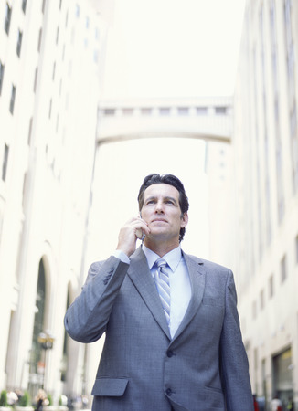 washed out: Businessman Using Cellular Phone