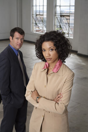 Portrait of Businesswoman with Businessman in Background