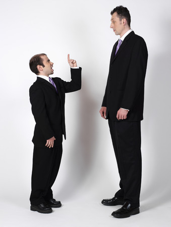 scolded: Short and Tall Businessmen LANG_EVOIMAGES