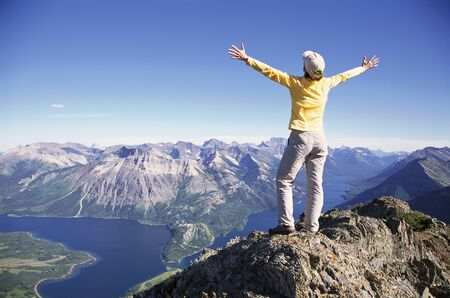 achievment: Woman Hiking, View from Randall Mountain, Waterton Lakes National Park, Alberta, Canada LANG_EVOIMAGES