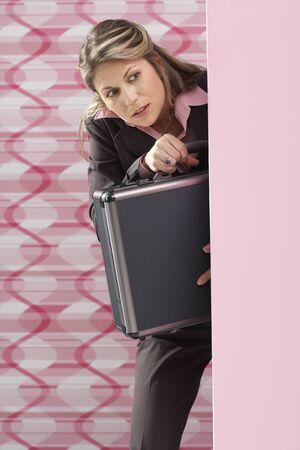 skepticism: Woman Peeking Around Corner