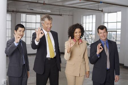sold small: Group Portrait of Business People Making Hand Gesture LANG_EVOIMAGES