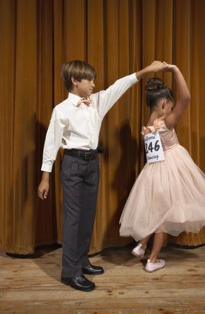 numeric: Boy and Girl Ballroom Dancing