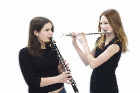 Teeenaged Girls Playing Flute and Clarinet LANG_EVOIMAGES