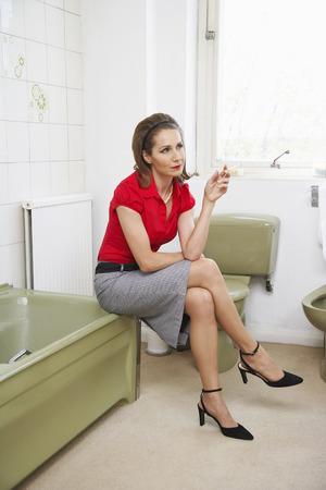 bathroom interior: Woman Smoking in Bathroom