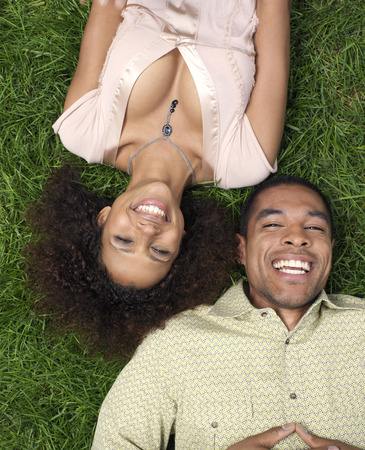 25 35: Couple Lying on Grass