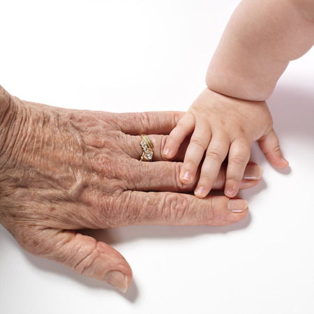 comparable: Babys Hand Touching Womans Hand LANG_EVOIMAGES