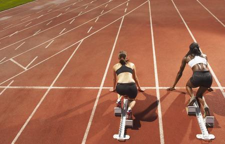 poised: Women Poised on Racetrack