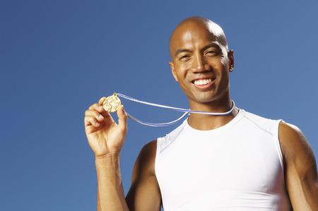 athletic wear: Portrait of Athlete Wearing Medal