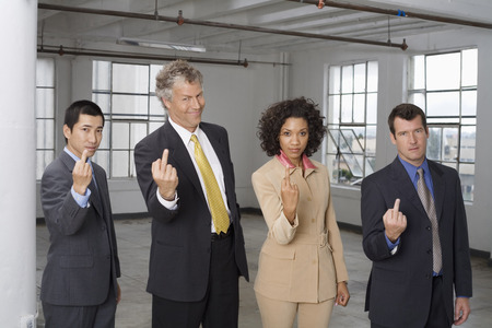 sold small: Group Portrait of Business People Making Rude Hand Gesture