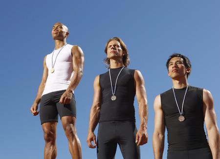 achievment: Champion Athletes Standing on Podium