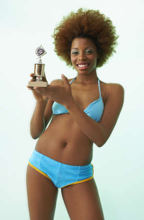 Portrait of Woman with Trophy