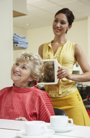 woman mirror: Women at Hair Salon