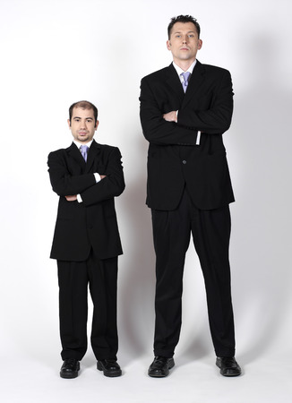 comparable: Short and Tall Businessmen LANG_EVOIMAGES