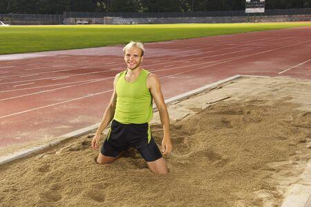 athletic wear: Man in Long Jump Pit