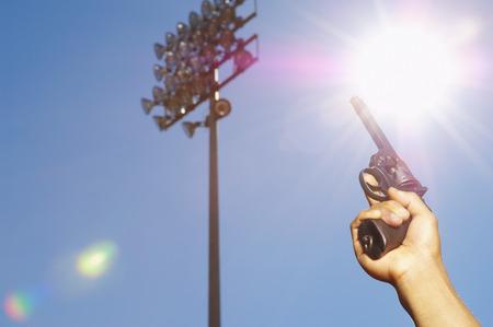 racetrack: Person Holding Starter Pistol LANG_EVOIMAGES