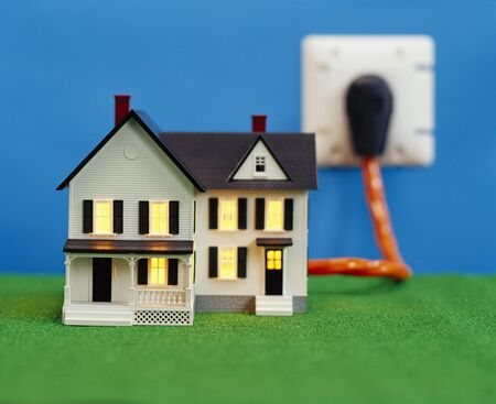 Miniature House Plugged into Electric Socket