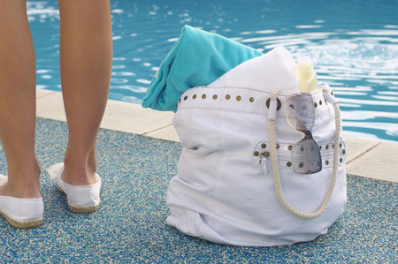 Woman with Bag beside Pool