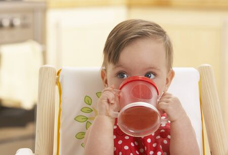Child in High Chair with Juice