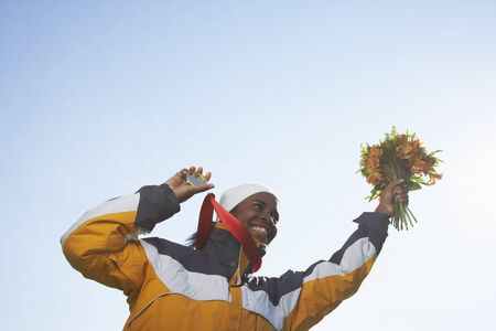 achievment: Woman Holding Medal and Bouquet LANG_EVOIMAGES