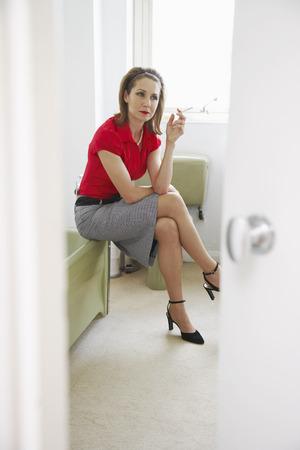 societal: Woman Smoking in Bathroom