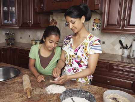 counter top: Mother and Daughter Cooking LANG_EVOIMAGES