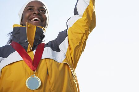 athletic wear: Portrait of Woman with Medal LANG_EVOIMAGES