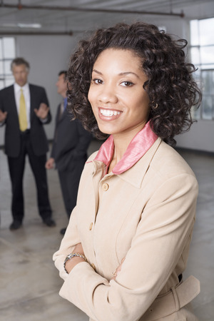 Portrait of Businesswoman with other Business People in Background LANG_EVOIMAGES