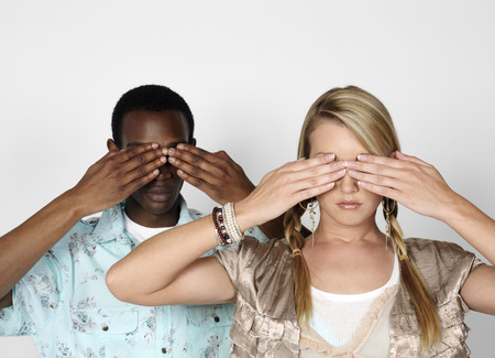 blinded: Couple with Hands Covering Eyes