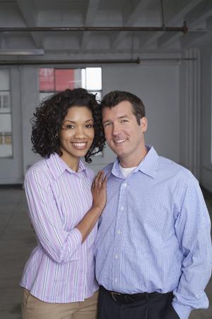 achievment: Portrait of Couple in Empty Loft Apartment
