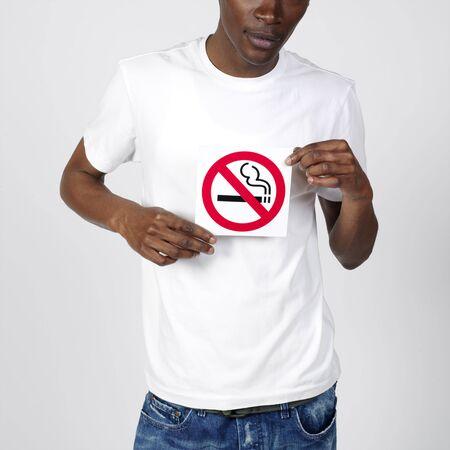 banning the symbol: Man Holding No Smoking Sign