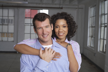 Portrait of Couple in Empty Loft Apartment