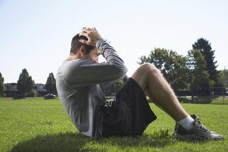 Man Doing Sit-ups Outdoors